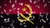 Angola flag falling snow loopable, New Year and Christmas background, loop.