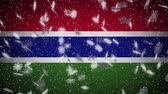 Gambia flag falling snow loopable, New Year and Christmas background, loop.
