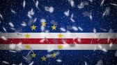 Cape Verde flag falling snow loopable, New Year and Christmas background, loop.