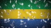 Gabon flag falling snow loopable, New Year and Christmas background, loop.