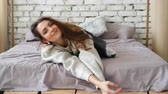 Young woman have fun and falling down from bed