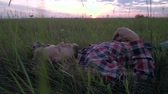 Man has a rest on the nature during sunset.