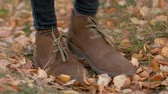 striding : close up - legs of a woman walking along the autumn trail, tourist walks in nature