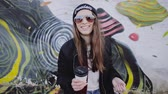 hipster : Happy young girl hipster having fun on city street slow motion