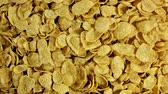 Pile of cornflakes in stop motion. Cornflakes scattered on a table. Top view. Background and texture