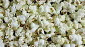 A lot of scattered salted popcorn in stop motion, texture background Vídeos
