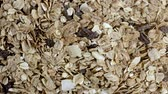 aveia : Background of Muesli Breakfast with oat flakes raisins in stop motion. Top view. The concept of Healthy eating