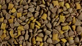 Pile of dry cat food in stop motion. Top view. Background of the granules Vídeos