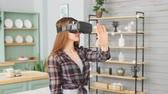 Young girl wearing virtual reality goggles. Handsome woman using VR headset at home