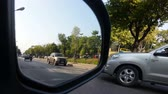 sideview : street view from car side mirror. Let all the cars pass by
