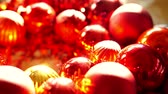 jemioła : Close up, Shiny red and gold Christmas ball mistletoe ornaments in morning new year light Wideo