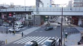 xing : Osaka, japan - March 2015 -Time Lapse Aerial View Pedestrians Crossing Crosswalk Cars Traffic in Japan