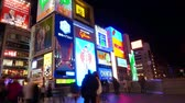 dotonbori : OSAKA, JAPAN - March 2015 - Time-lapse shot of  Glico billboard Osaka landmark in Dotonbori Stock Footage