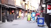 maiko : KYOTO, JAPAN - March 2015: Maiko, young training geisha walks on the streets of Gion area in Kansia Stock Footage