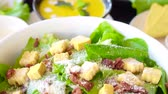 parmesão : Beautiful colourful caesar salad with dressing croutons and parmesan cheese together with yellow pumpkin soup. healthy meal