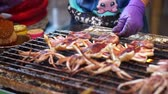 squid tentacles : Grilling bbq squid, Street Food, Asia night market Stock Footage