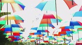 brilho : Street farm area decorated with rainbow colored umbrellas all over. Abstract fun and lively