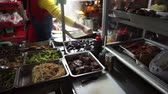 resemble : Taiwanese Chinese vegetarian food stall. Many dishes resembling meat and other kind of food Stock Footage
