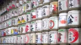сакэ : Tokyo, Japan - September 2016: Meiji shrine wall of sake barrels offer for festival and Japanese god
