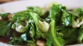 stir fried vegetables : Bok choy or Chinese broccoli green vegetable stir fry with sauce in Thai Chinese restaurant