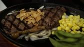 corn : Beef Steak Premium beef steak in sizzling pan with corns and peas side dish 4k video