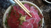 főétel : Beef Tataki video. Hand using chopsticks eating Japanese raw meat slice in restaurant Stock mozgókép