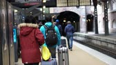 Дания : Asian tourists walking at train station in Copenhagen, Europe video