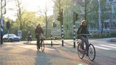 ride to work : Amsterdam, Netherlands - 4 April 2017 : People biking after work, green city at sunset