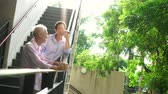 family business : Asian elderly professional couple talking outdoor morning in city modern building Stock Footage
