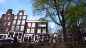 classic architecture : Amsterdam, Netherlands - 4 April 2017: Amsterdam city architecture view from tourist cruise Stock Footage