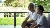 money thai : Stress Asian Senior Couple talking on finance and health problems Stock Footage