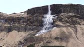 frozen waterfalls : Majestic Iceland Frozen Waterfall On High Cliff Volcanic Landscape Stock Footage