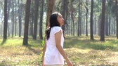 atem : Asian Ethnic Woman standing running To See Beautiful Forest slow motion Stock Footage