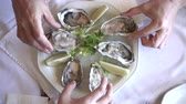устрица : Eating Fresh South Africa Oyster with lemon platter Стоковые видеозаписи