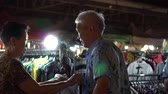tentação : Asian Senior Couple Shopping For Hawaii Shirt In Thailand Street Market Stock Footage