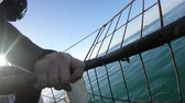 fins : Tourist Getting In Shark Cage Diving In South Africa