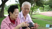 koszty : Asian Senior Couple Have Financial Problem No Money