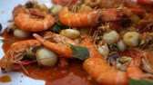 ahtapot : Seafood Bucket Prawn With Red Cajun Sauce Hand Eating With Plastic Glove
