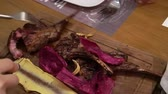 grelhar : Cutting Lamb Rack Barbeque Steak In Wood Stock Footage