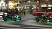 atividades : Tokyo, Japan - 23 Sep 2016: Mario Cart Driving Tourist Attraction In Shinjuku Video Vídeos