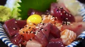 Japanese food assorted sashimi don with wasabi and yolk Стоковые видеозаписи