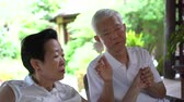стол : Asian elderly couple worry with health and sickness plan