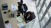стол : Diversity team working in modern office from top view