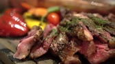 Beef steak medium rare cut serve on slate plate Stok Video