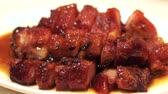 Hong Kong Chinese barbecue honey pork cuisine Stok Video