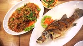 Top view eating Thai seafood whole fried fish and prawn garlic