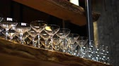 üvegáru : Cocktail glasses lines up on wood loft style bar shelves