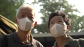 Asian Chinese couple aware of 2019 ncv outbreak and smog situation wear preventing mask