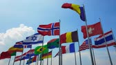 International colorful national flags sway in outdoor wind abstract of world collaboration