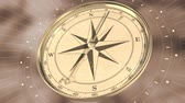 orientace : Vintage gold compass on blurred motion background